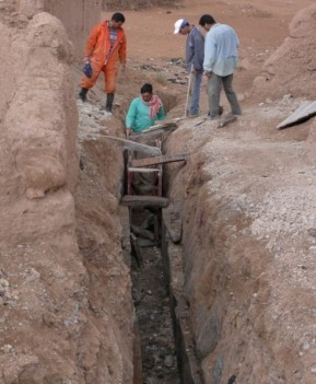 Repairing an irrigation canal in El Khorbat, south Morocco.